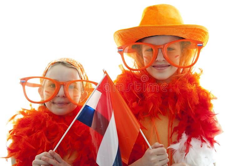 orange dräkt två för flickor arkivfoto