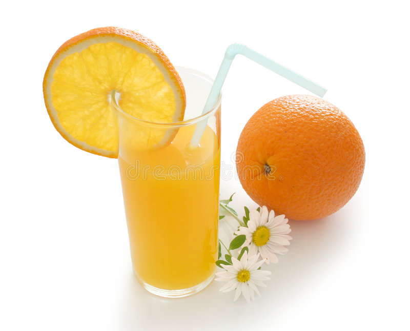 Orange drink. Fresh orange drink and flowers royalty free stock photos