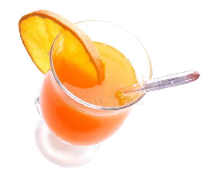Orange drink. Fresh orange drink on the white background royalty free stock image