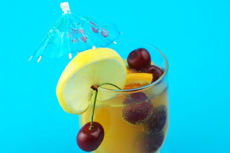 Orange Drink On Blue Stock Photography