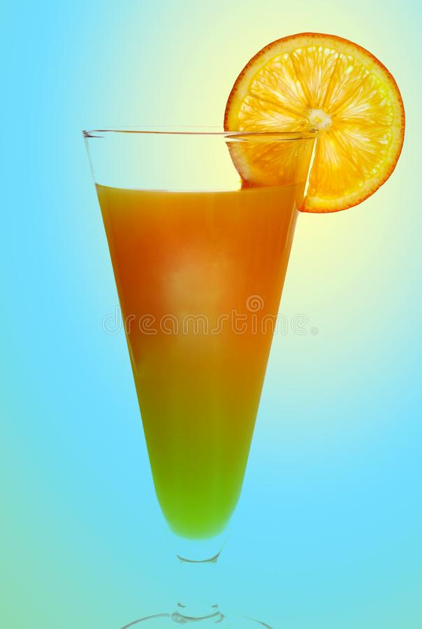 Orange drink with orange slice on side royalty free stock images