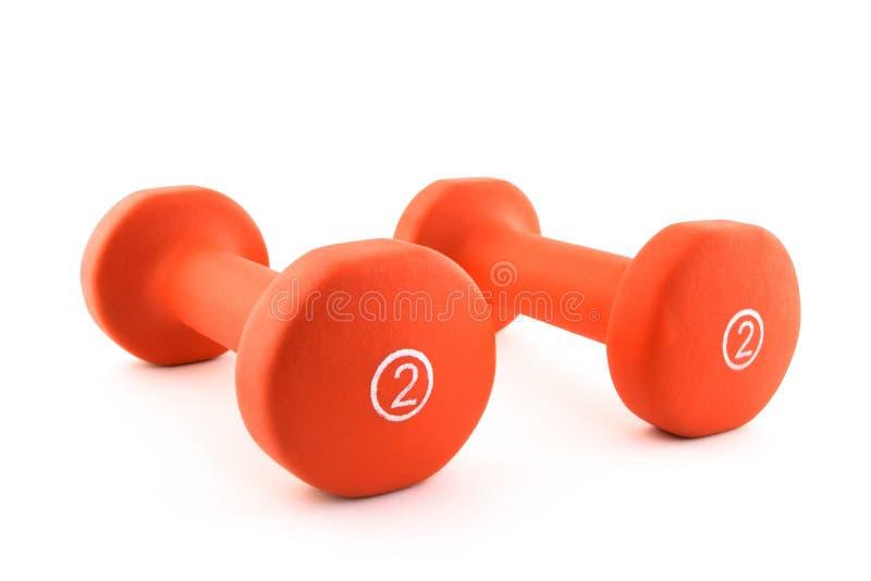 Orange Dumbbells lizenzfreie stockfotos