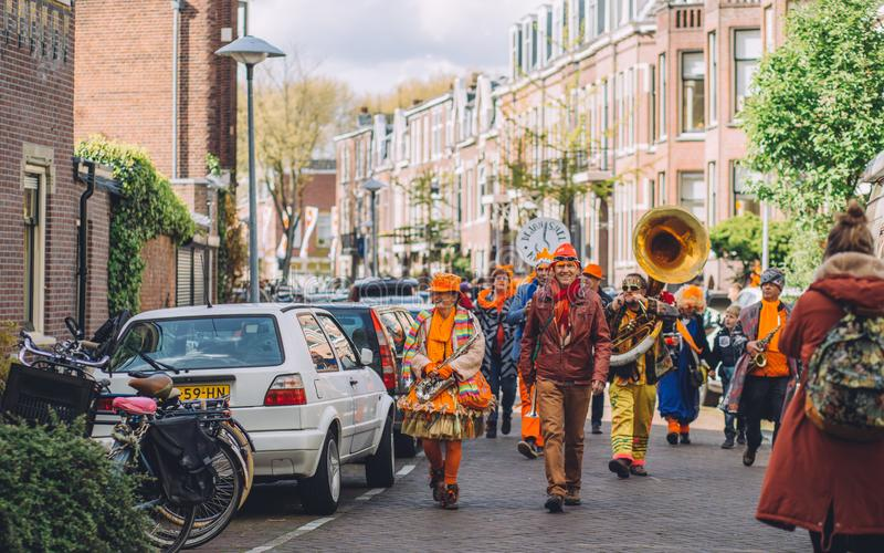 Orange dutch band during King`s Day festivity, street festival. National celebration royalty free stock image