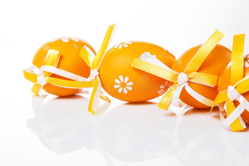 Orange Easter eggs. On a white background stock photography