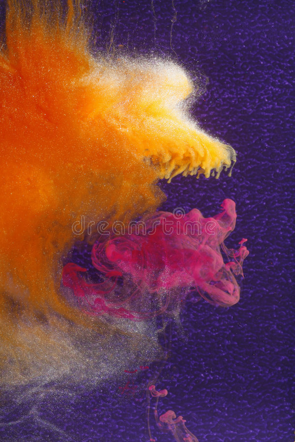Orange eating magenta clouds. Cloud of orange-gold in space, swallowing a cloud of magenta with deep violet background stock image