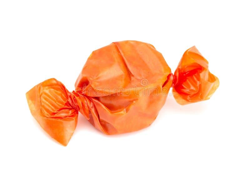 Orange eingewickelte Süßigkeit stockbild