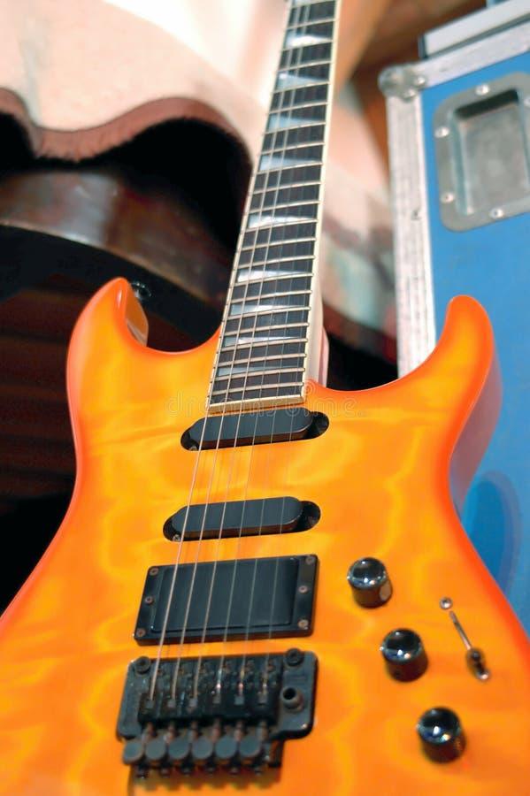 Orange Electric Guitar royalty free stock images