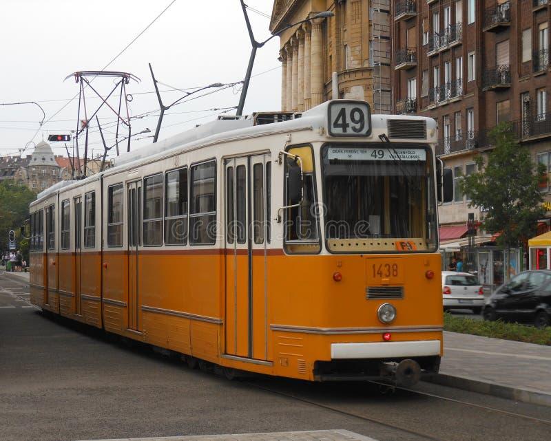 Orange electric tramway royalty free stock photos