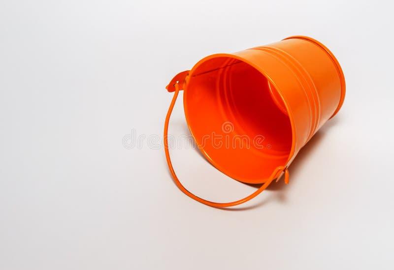 Orange empty pail, orange bucket on white background. stock image
