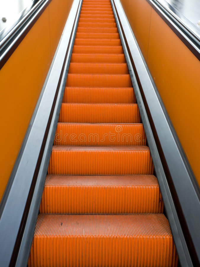 Orange escalator stock photos