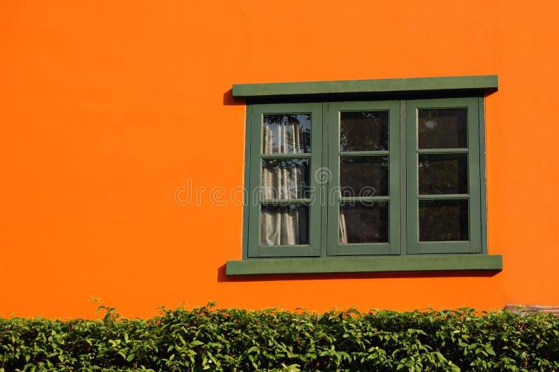 Orange et hublot photographie stock libre de droits