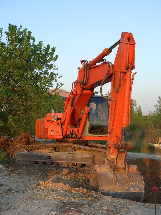 Orange Excavator Vertical Stock Photos
