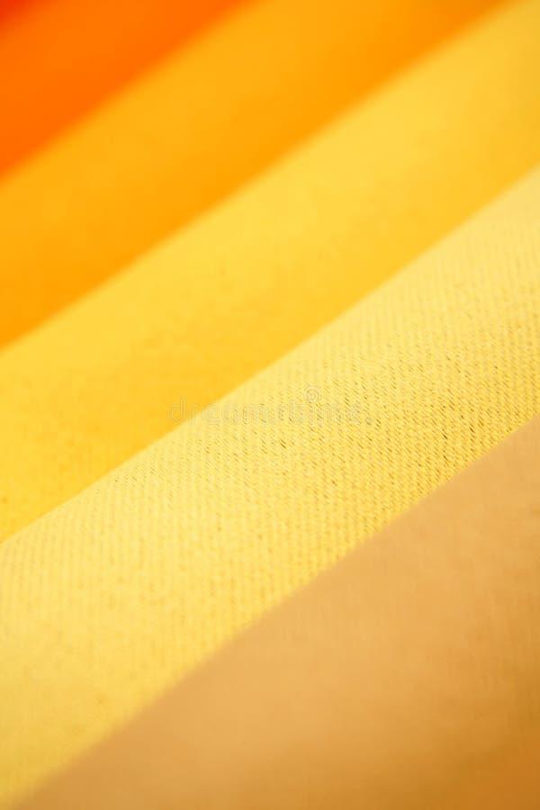 Orange fabrics background stock images