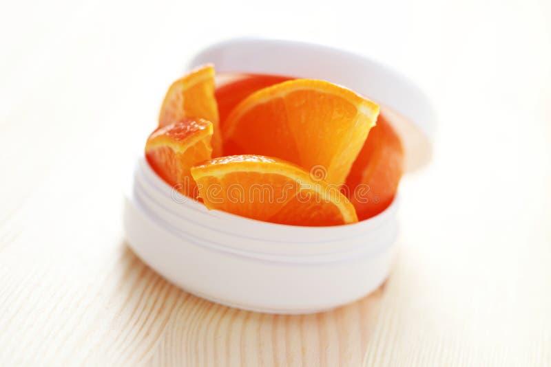 Orange face cream stock images
