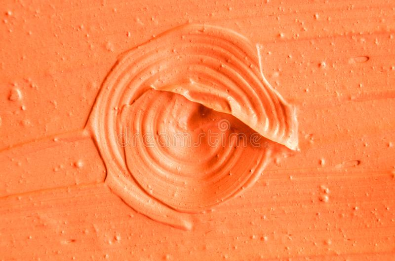 Orange facial mask pumpkin cream, body scrub texture close up. Abstract background with brush strokes. Pain texture backdrop royalty free stock image