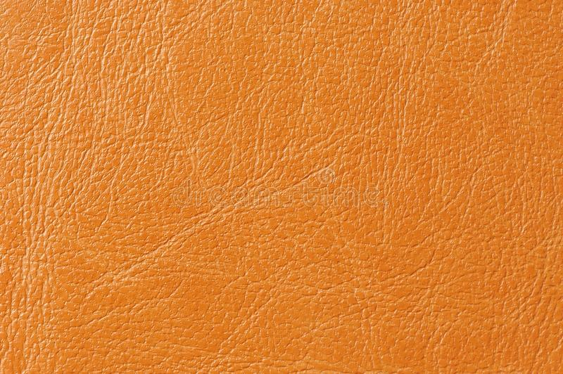 Orange Faux Leather Background Texture. A macro shot of orange faux leather background texture stock photography
