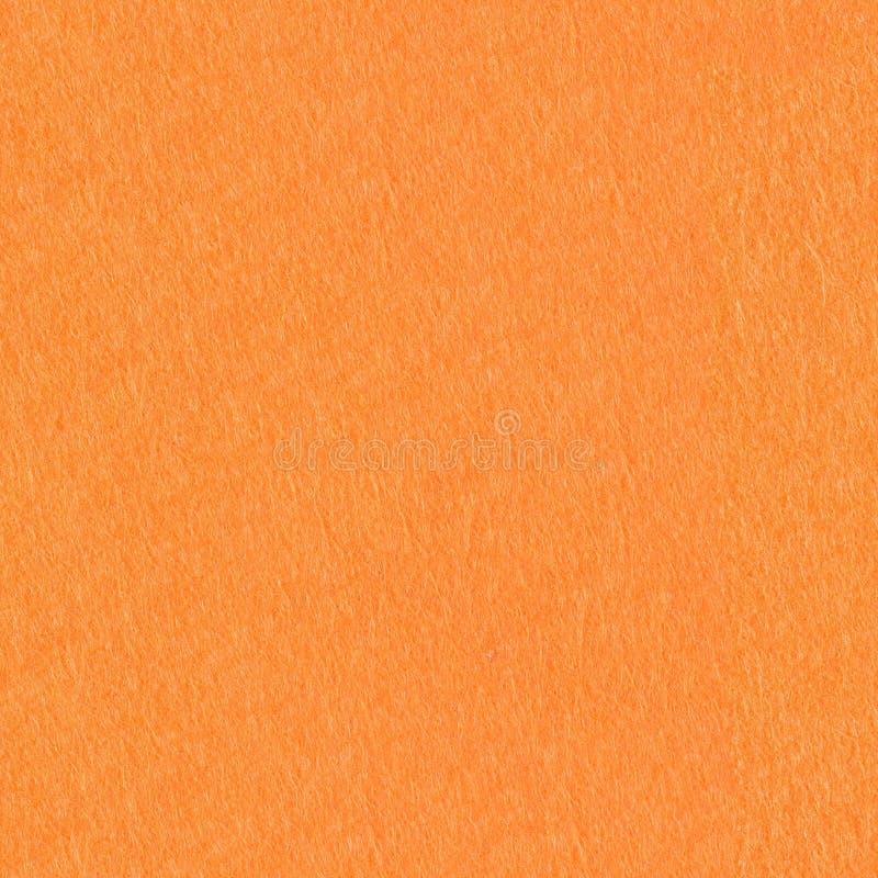 Orange felt background on macro. Seamless square texture, tile ready. High resolution photo stock photos