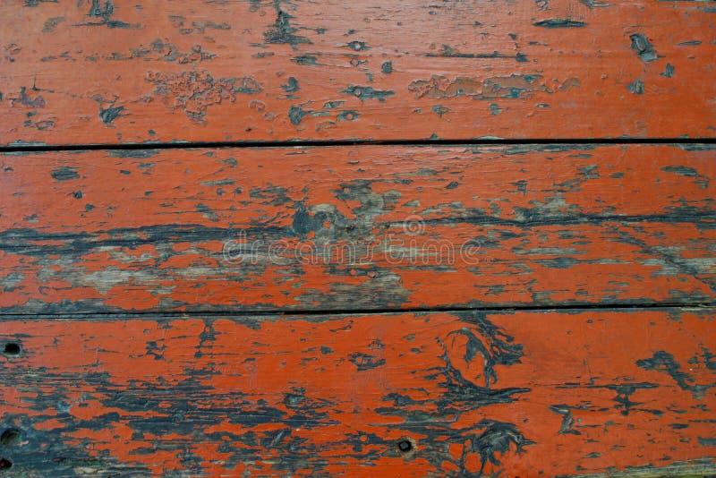 Orange fence of wooden planks stock photos