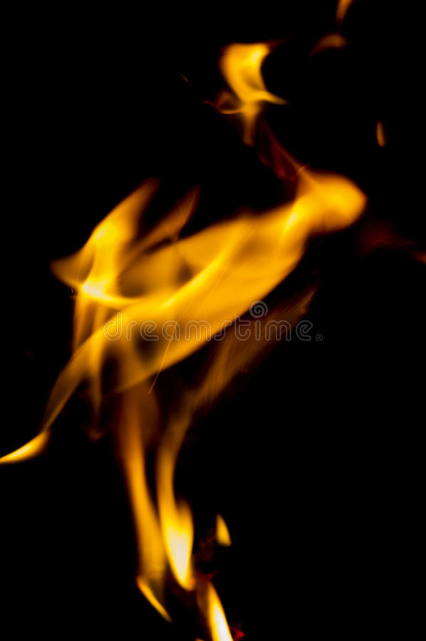 Orange fire flames. On the black background stock image