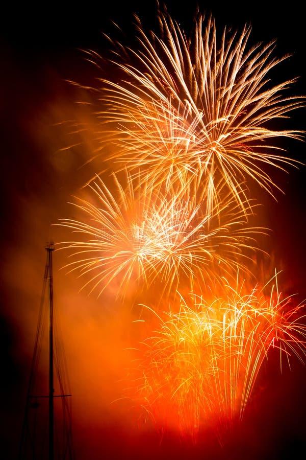 Orange fireworks. Colorful fireworks isolated on black background. New years eve celebration royalty free stock photos