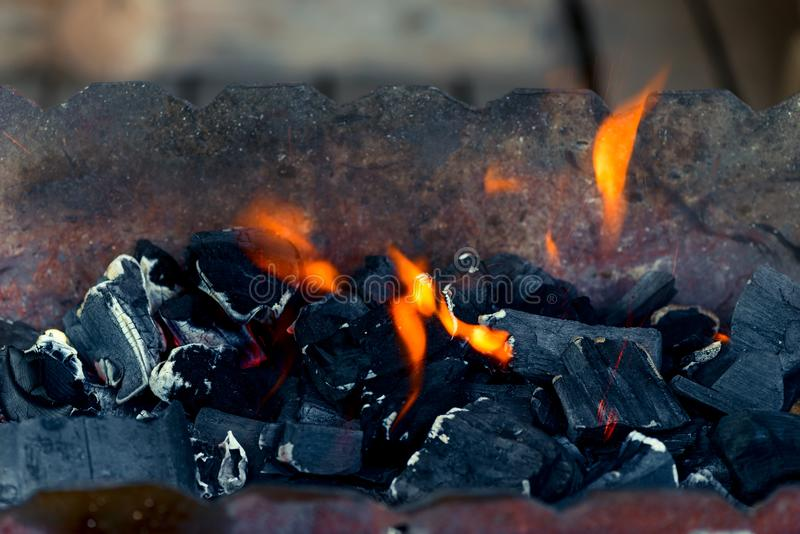 Orange flame and black coals - bonfire royalty free stock photos