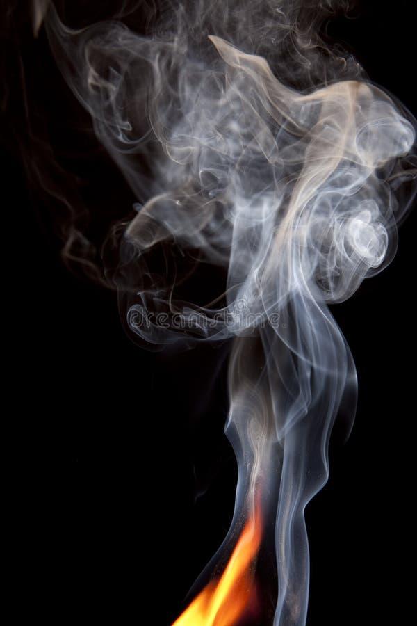Orange Flame With Smoke Rising Stock Photography