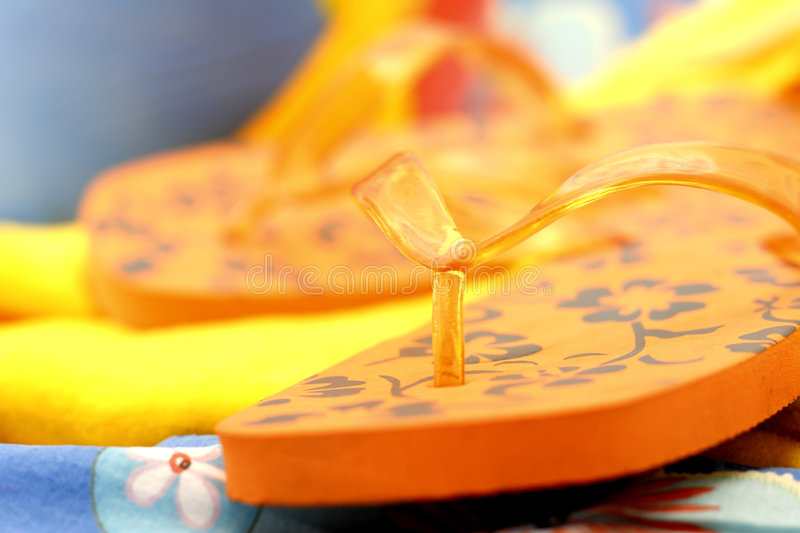 Orange flip flops stock images