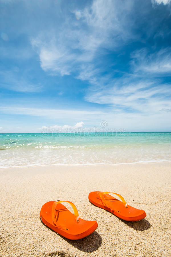 Orange flip-flops stock photography