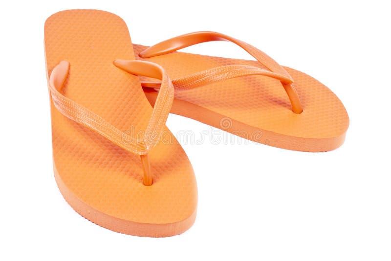 Orange Flipflops stockfotos