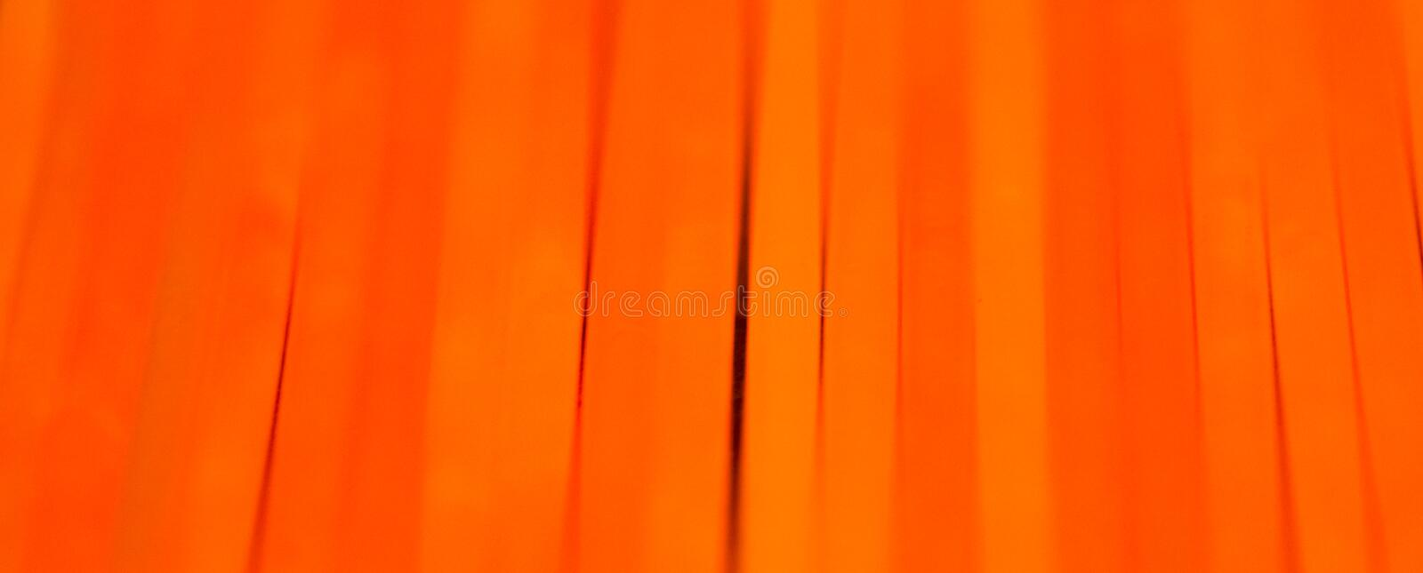 Orange fluorescent chem light neon black background. Orange colorful colored fluorescent chem light neon tube with reflection on mirror with black background royalty free stock photography