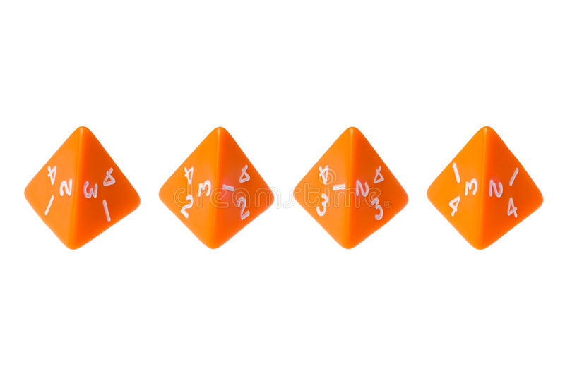 Orange four sided dice for board games stock images