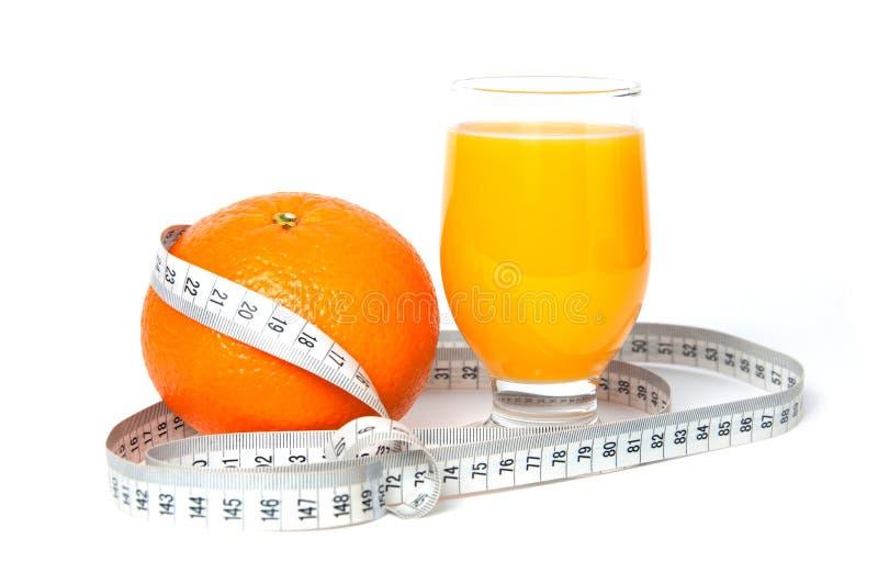 Orange Frucht und Saft mit Maßband stockbild