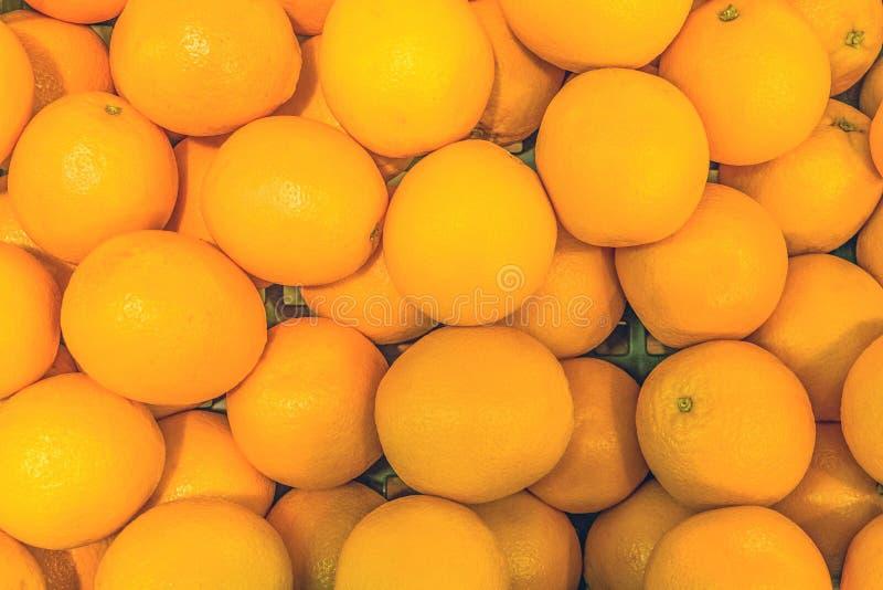 Orange fruit background in market royalty free stock image