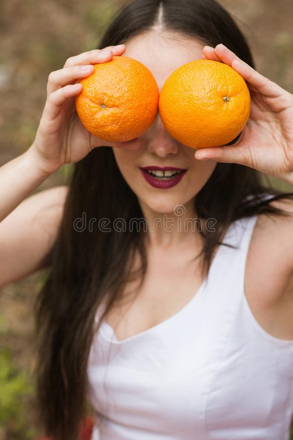 Orange fruit nature woman joking healthy concept. stock images