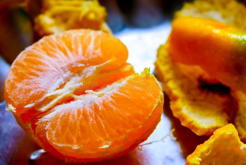 Orange Fruit pealed nad cut. Orange Fruit Pictures, Images and Stock Photos, orange pealed and cut into pieces stock image