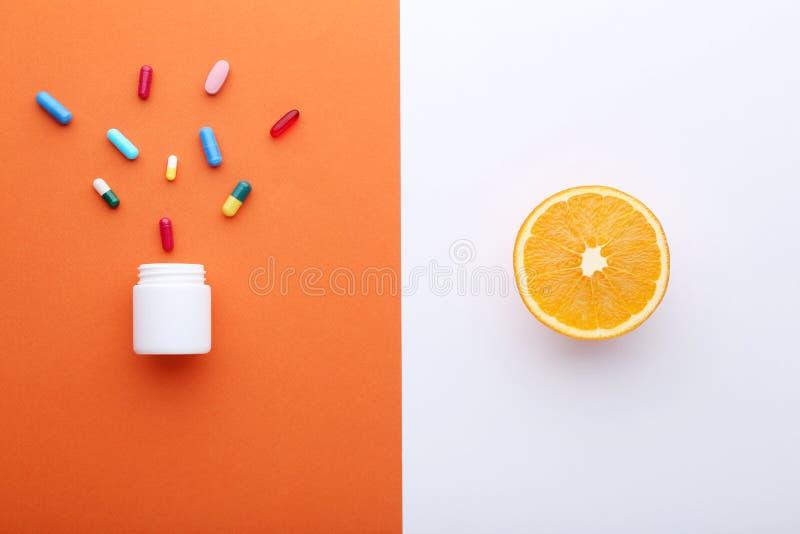 Orange fruit and pills royalty free stock photo