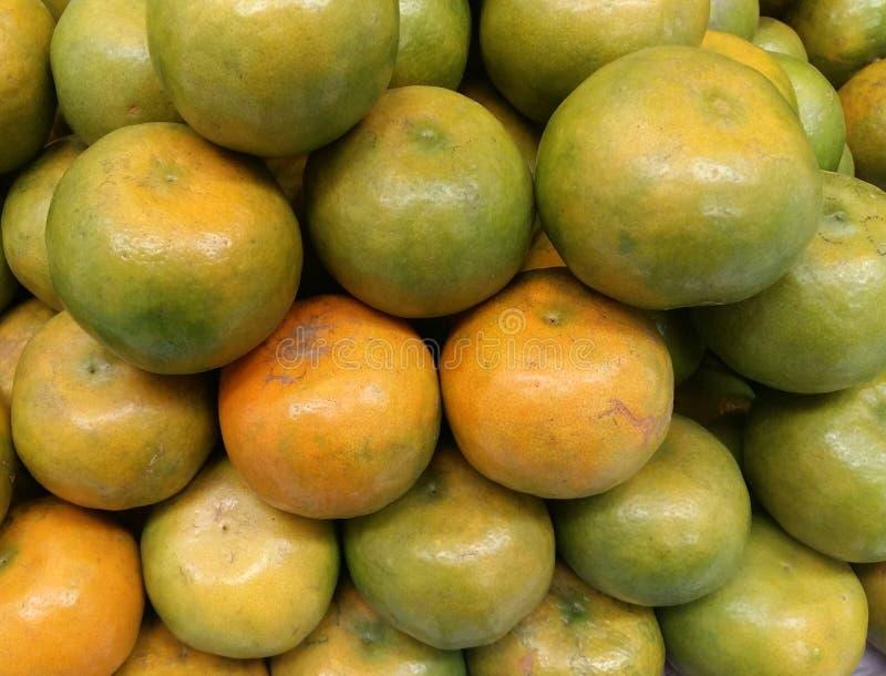 Orange fruit for sale. At market stall royalty free stock image
