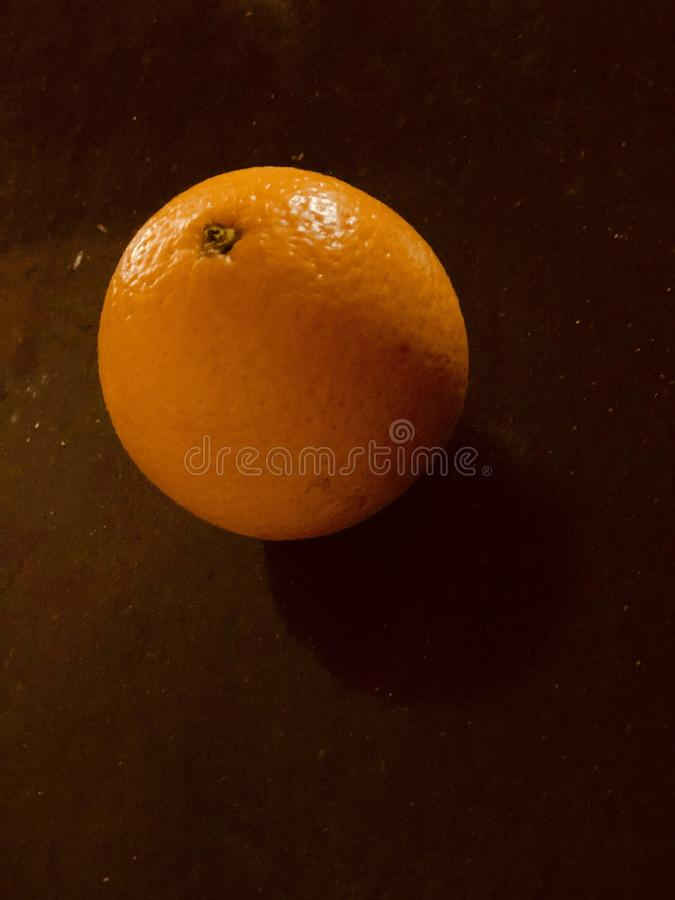 Orange fruit on wood. For background or designs layouts stock photo
