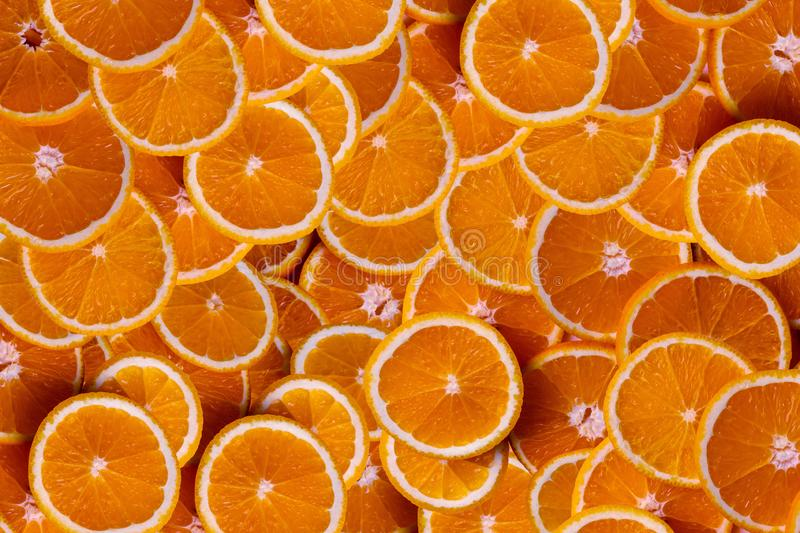 Orange fruits full frame background and texture. The result is sour or sweet. Contains calcium, potassium, vitamin A and C, summer, organic, diet, juicy, slice stock photography