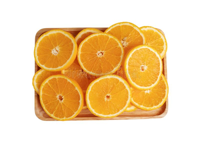 Orange fruits sliced into pieces on the wooden plate with isolated white backgrounds. The result is sour or sweet. Contains calcium, potassium, vitamin A and C royalty free stock images