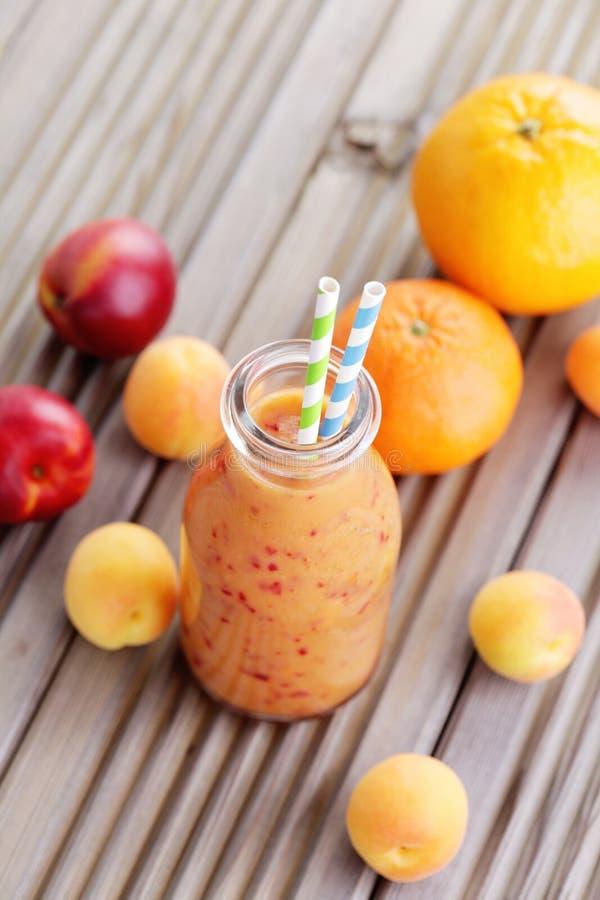 Orange fruity smoothie stock photography