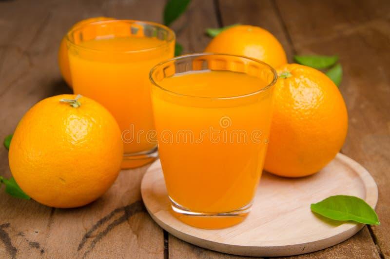 Orange frukt och fruktsaft royaltyfri foto