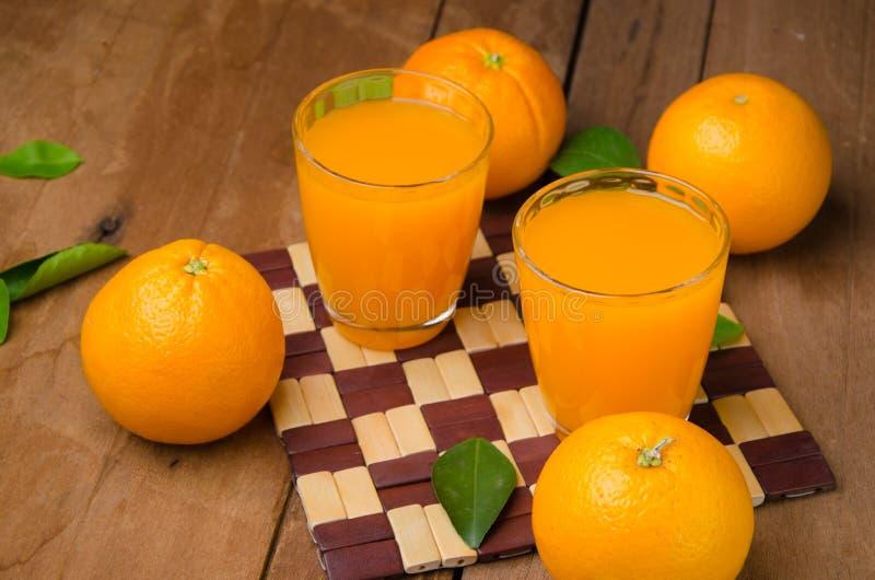 Orange frukt och fruktsaft royaltyfri bild