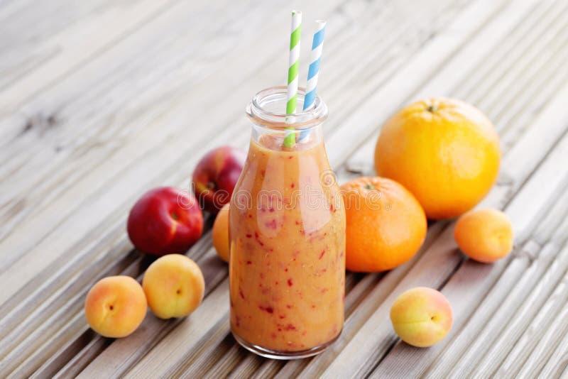 Orange frukt- smoothie royaltyfria bilder