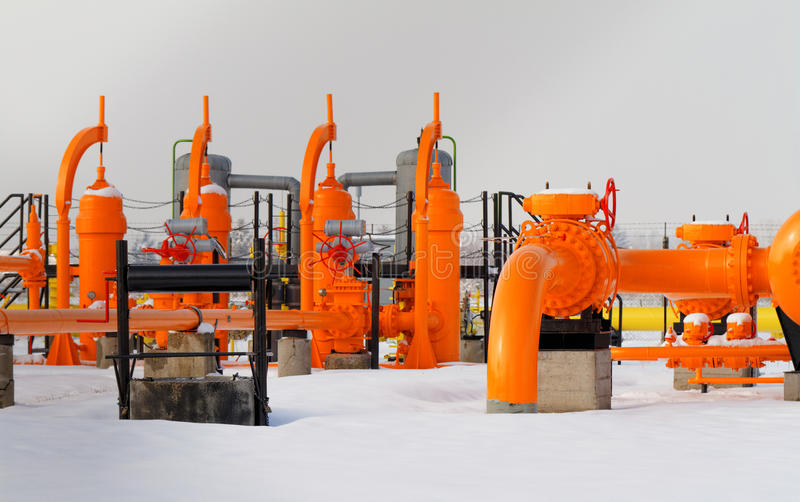 Orange gas pipe. In frosted winter stock image