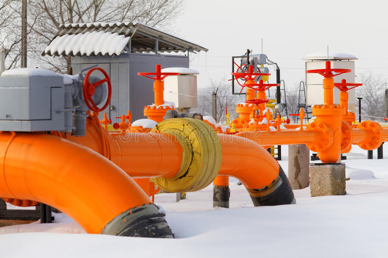 Orange gas pipe. In frosted winter stock images