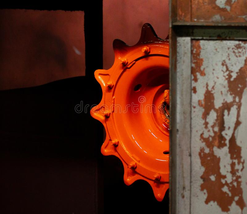 Orange gear on painting. Half the details. Rusty items royalty free stock photography