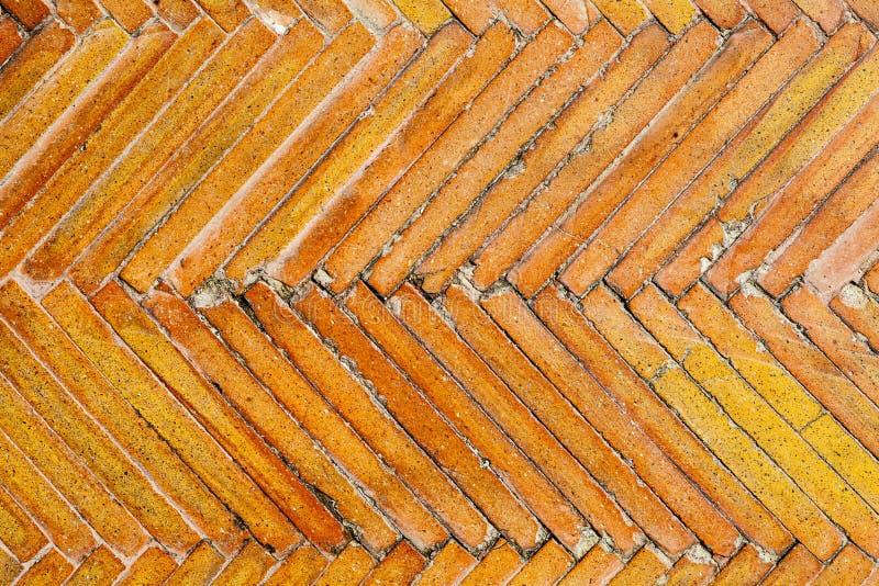 Orange geometrisk modell för tegelplattatextur Gammal yttersidadesign för golv arkivfoton