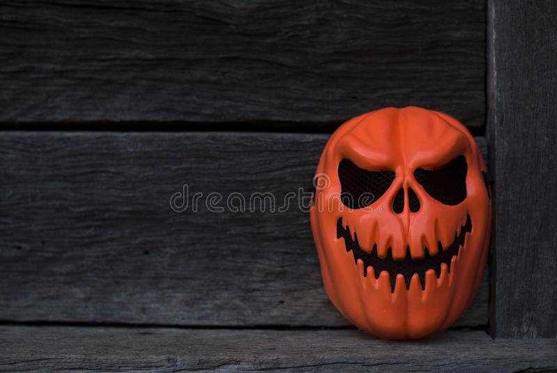 Orange Ghost Mask placed in an old house in the dark royalty free stock photos