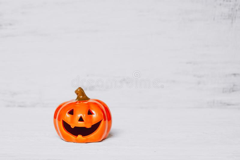 Orange ghost pumpkins on grunge rusty white wooden borad background with copy space for your text. halloween background minimal. Concept, artwork, autumn stock photos